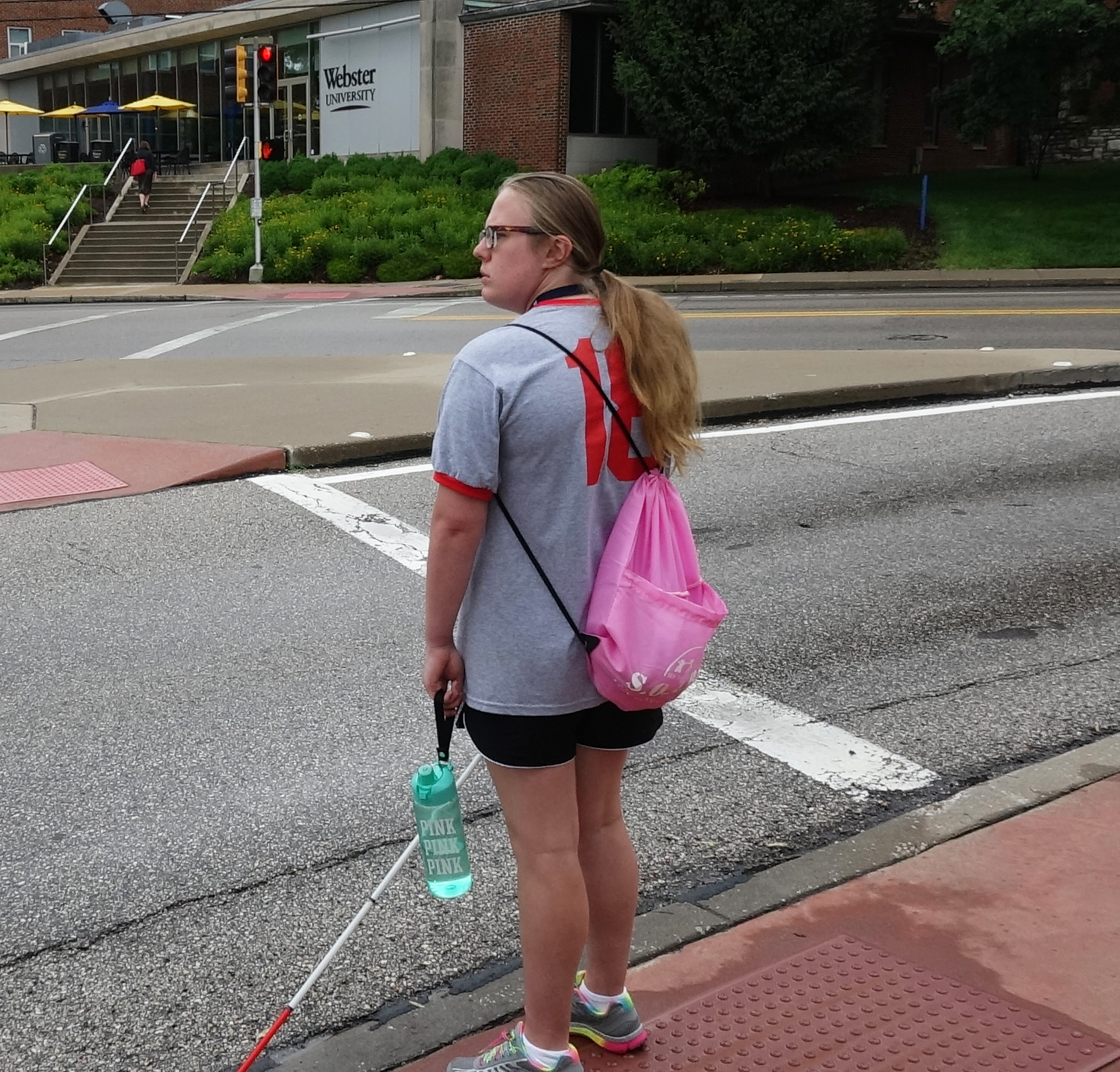 Kristin Completes Her Daily O&M Lesson Outside Webster University.
